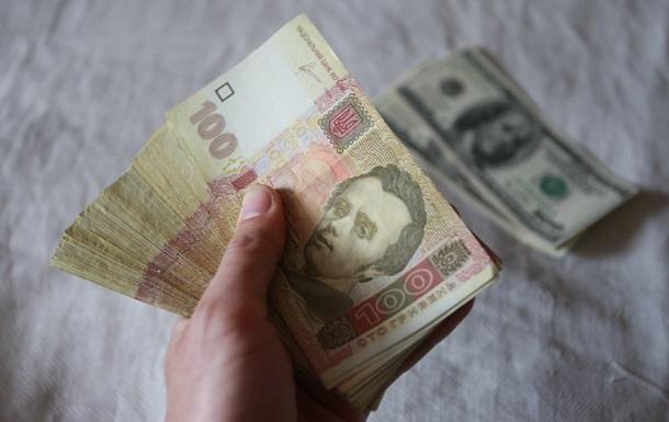 У разі подвійного зростання інвестицій у наступному році курс долара може опуститися до 24 гривень, вважають у Кабміні.