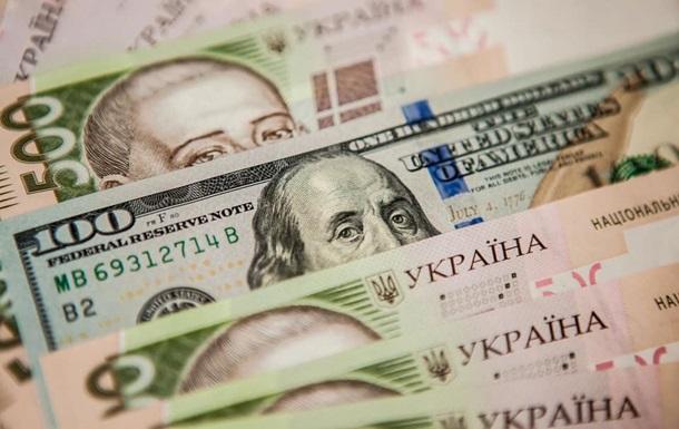 Офіційний курс гривні відносно долара зріс на 39 копійок. Таке котирування діятиме до 3 січня через вихідні.